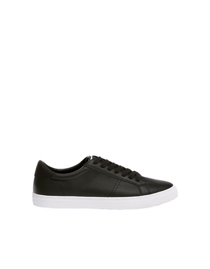 Black die-cut trainers