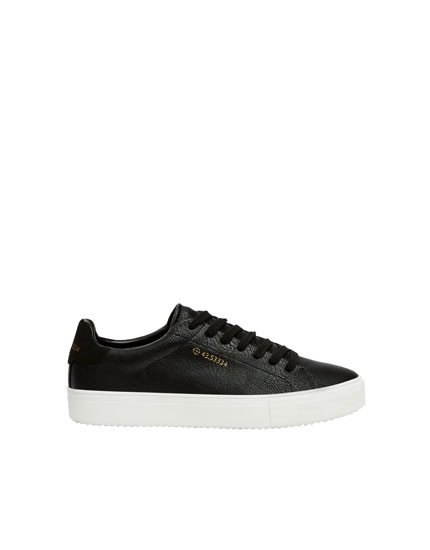 Black trainers with coordinates detail