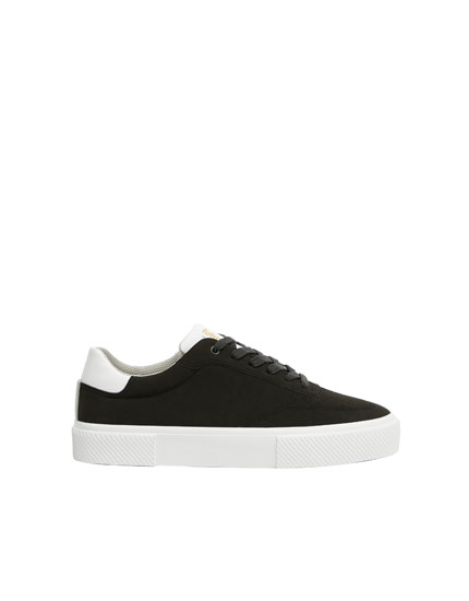 Black platform sole trainers