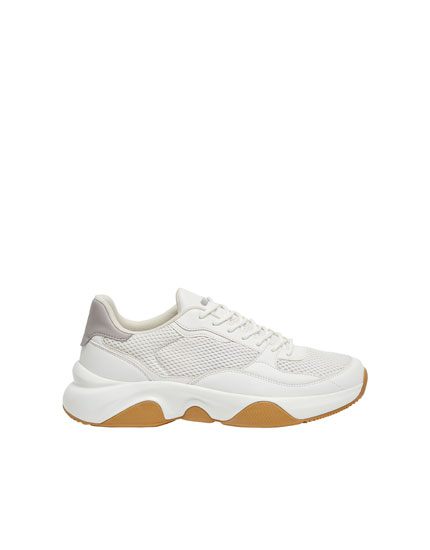 White trainers with caramel soles