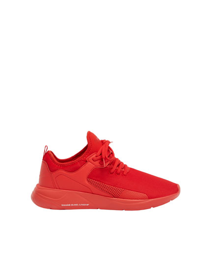 Red multi-material trainers
