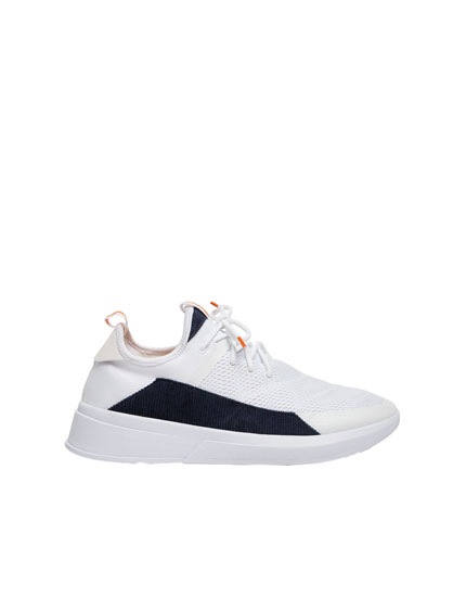 White trainers with corduroy side panel