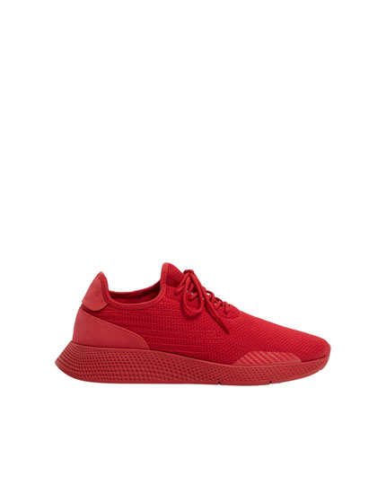 Red sock-style trainers