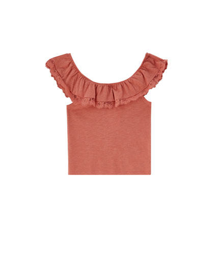 Sleeveless top with ruffled neckline
