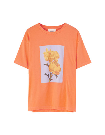 Orange T-shirt with flowers