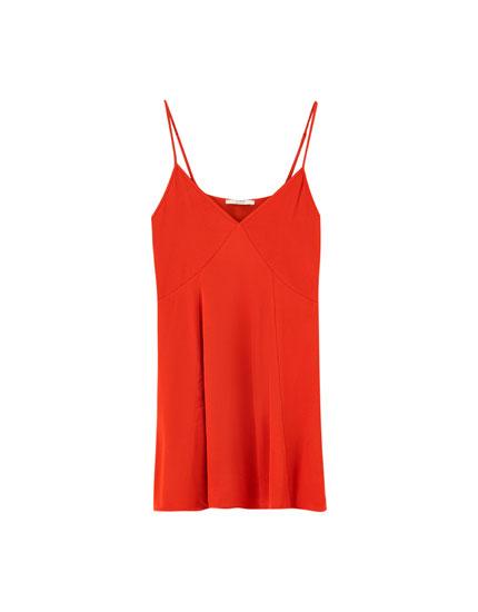 Lace-trimmed mini dress with uneven hem