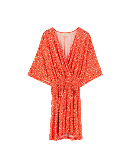 Short shirred coral dress