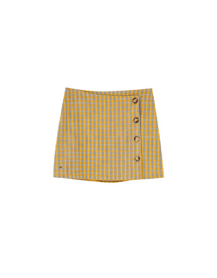 Check mini skirt with side buttons