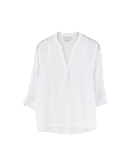 Basic shirt with stand-up collar and epaulettes