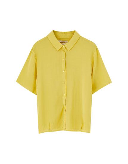 Camisa básica manga corta lisa