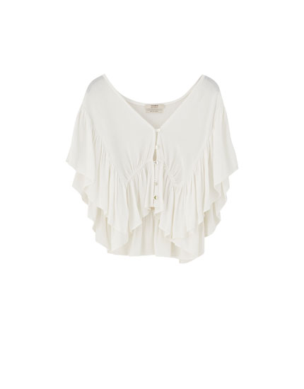 Blouse with front ruffles