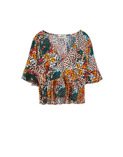 Ruffled animal print blouse