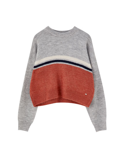 Pull color block bande poitrine
