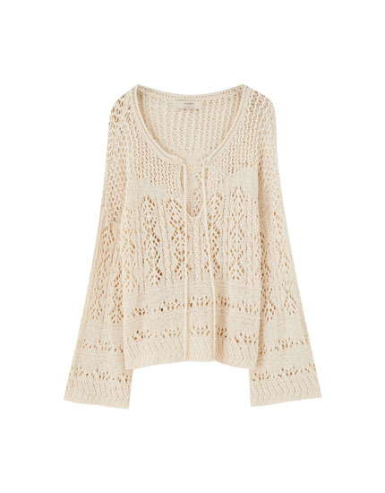 Open knit sweater with tied detail