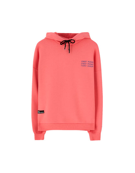 Sweat capuche inscription manche