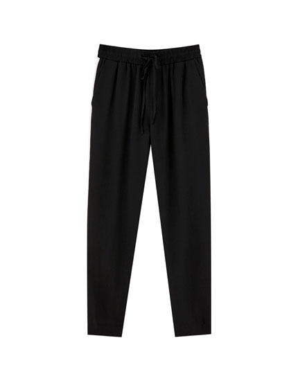 Jogging trousers with side bands