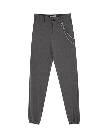 Tailored trousers with elastic cuffs
