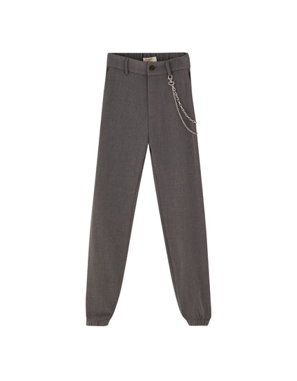Trousers with elastic cuffs and chain detail