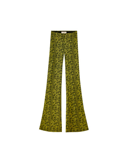 Flared snakeskin print trousers
