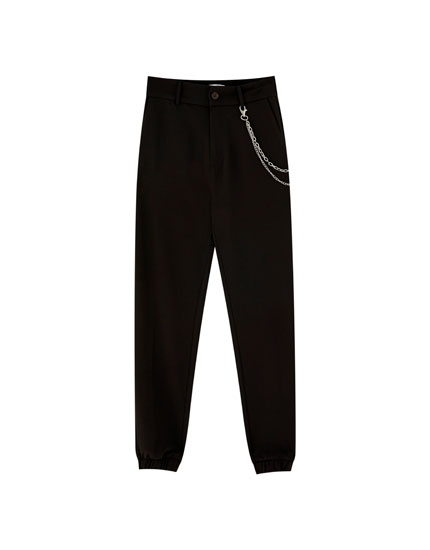 Trousers with chain and elastic hems
