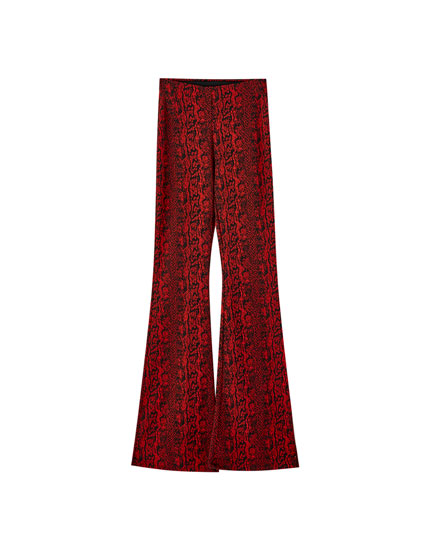 Snakeskin print flared trousers