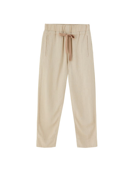 Rustic trousers with bow at the waist