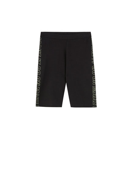 Pantaloni tip cycling cu text lateral