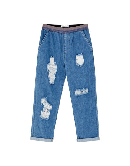 Jeans baggy strappi