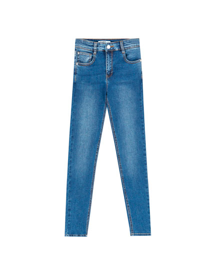 Jeansy skinny ze średnim stanem i przetarciami