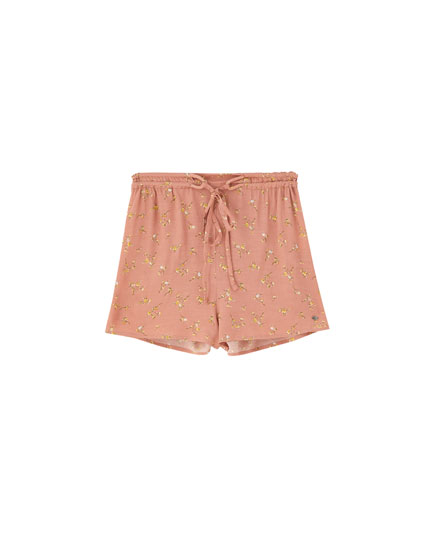 Pink shorts with small flower print