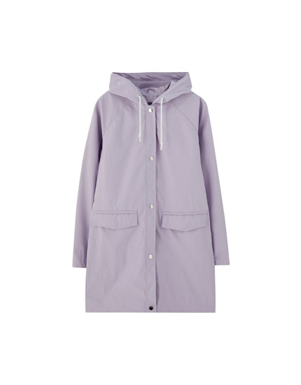 Raincoat with flap pockets