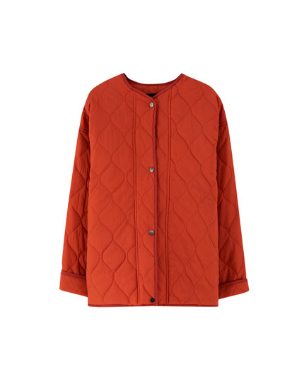 Buttoned jacket with quilted lining