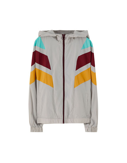 Windbreaker with V-shaped panels