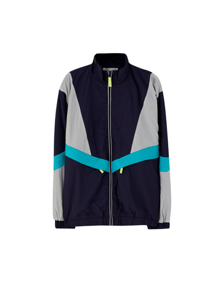 Panelled windbreaker with neon zip pull