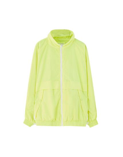 Neon yellow jacket with raglan sleeves