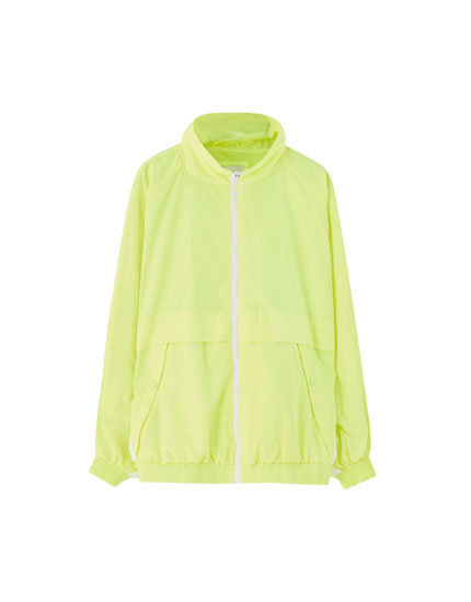 Neon yellow jacket with raglan sleeves