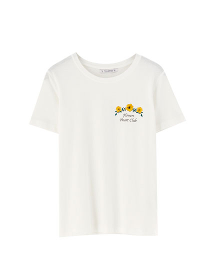 Short sleeve T-shirt with slogan and flower design