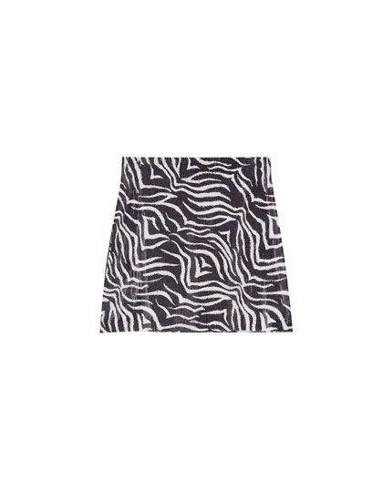 Lårkort nederdel med pailletter og zebraprint