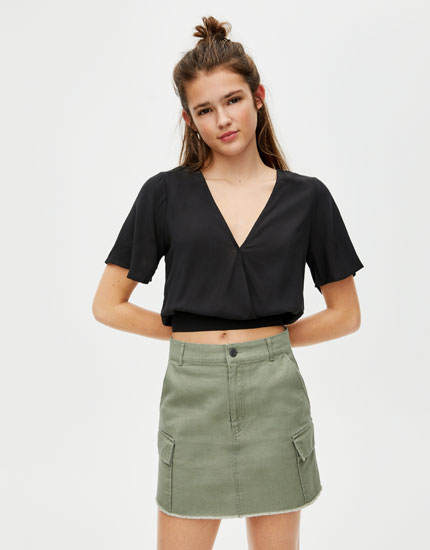 Blouse with open criss-cross back