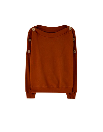 Sweatshirt with buttoned shoulders
