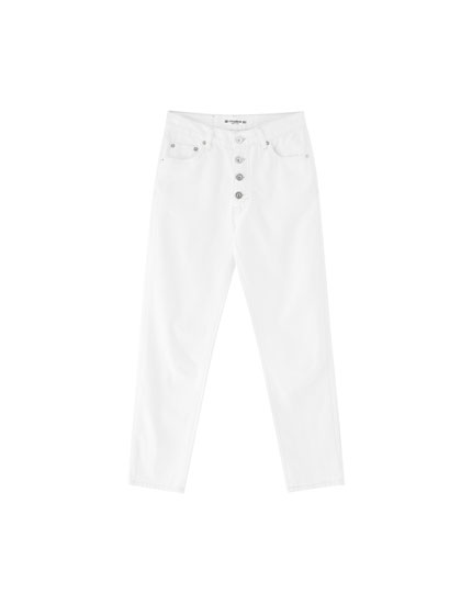 Mom jeans with visible buttons