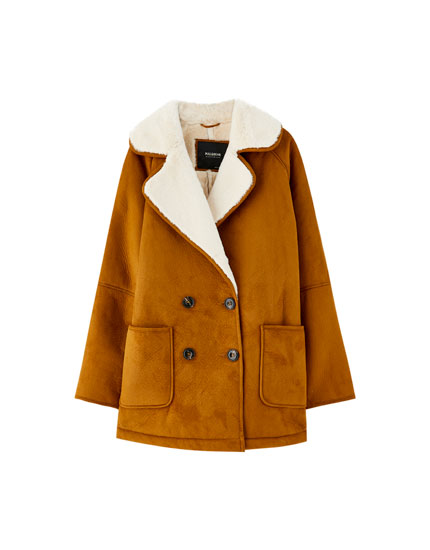 Double-sided coat with faux shearling lining