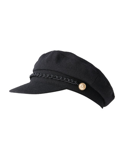 Nautical cap with golden button
