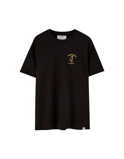 Skater-t-shirt med lille gris og tekst