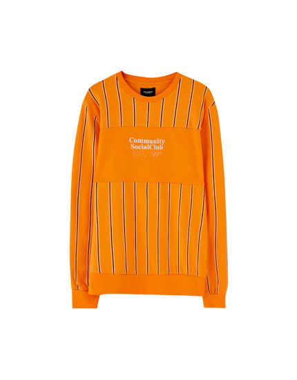 Vertical stripe sweatshirt with slogan panel