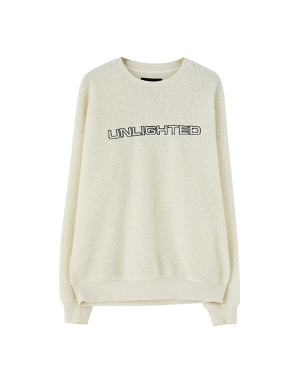 Faux shearling sweatshirt with embroidered slogan