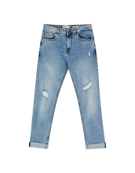 Slim comfort fit jeans with ripped knees
