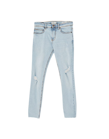 Light blue ripped super skinny jeans