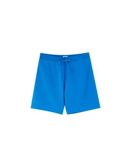Bermuda-style joggers in bright colours