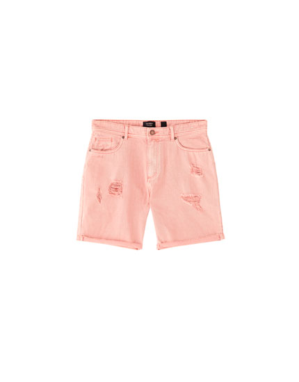 Coloured Bermuda shorts with rips